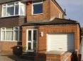 Single storey garage extension with rear utility room