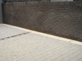 """Raked out"" joints to partion brick wall and block paved walkway"