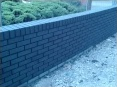 Radius wall with raked out joints