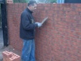 Bricklayer constructing the wall to the porch extension