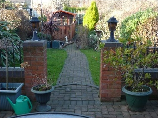 Block paved patio area and meandering garden path