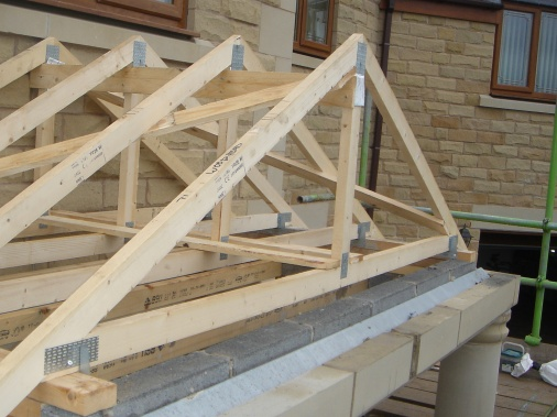 Roof trusses spaced out at 350mm centres and braces for stability