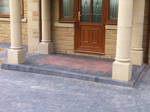 Feature matwell formed in brindle paving to form entrance as a contrast
